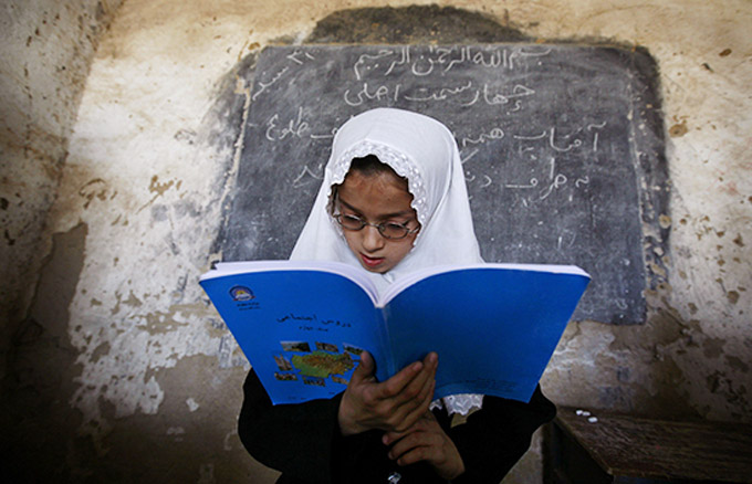 An Afghan Girl Reads In Front Her Class At The Girls High School Ayeshe Sedeqa In The Center Of Kunduz, Northern Afghanistan, Sunday, Sept. 21, 2008. © Anja Niedringhaus/ AP/picture Alliance