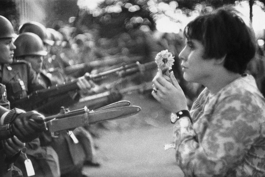 Young Girl Holding A Flower, Demonstration Against The War In Vietnam, Washington D.C., 1967 © Marc Riboud